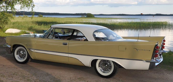 1957 DeSoto with Chrysler style wire wheels and whitewall tires.