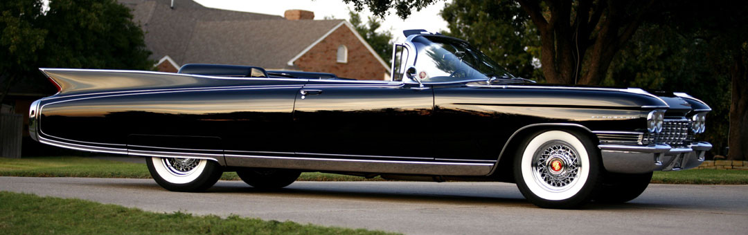 1960 Cadillac Eldorado with chrome wire wheels and whitewall tires.
