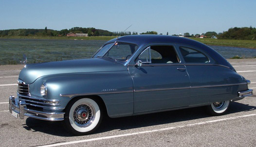 1950 Packard with wire wheels.