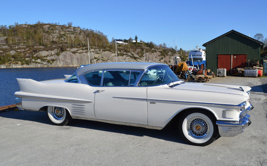 1958 Cadillac with whitewall tires and chrome Truespoke rims.