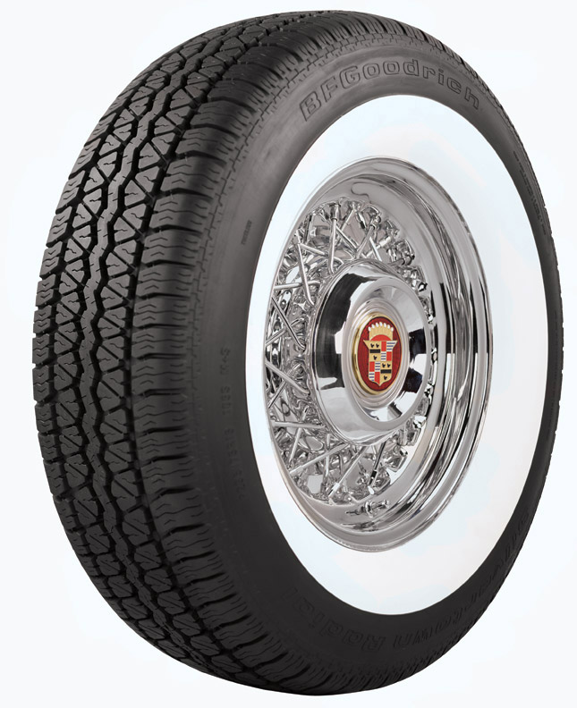 BF Goodrich white wall tire on a Cadillac chrome wire rim.