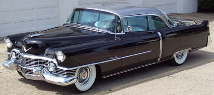 1954 Cadillac with whitewall tires and chrome spoked wheels.