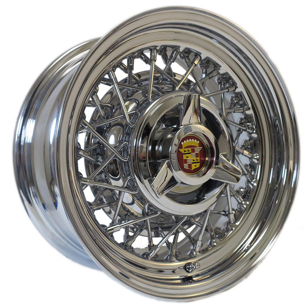 Cadillac wire wheel with a 3-bladed spinner cap.
