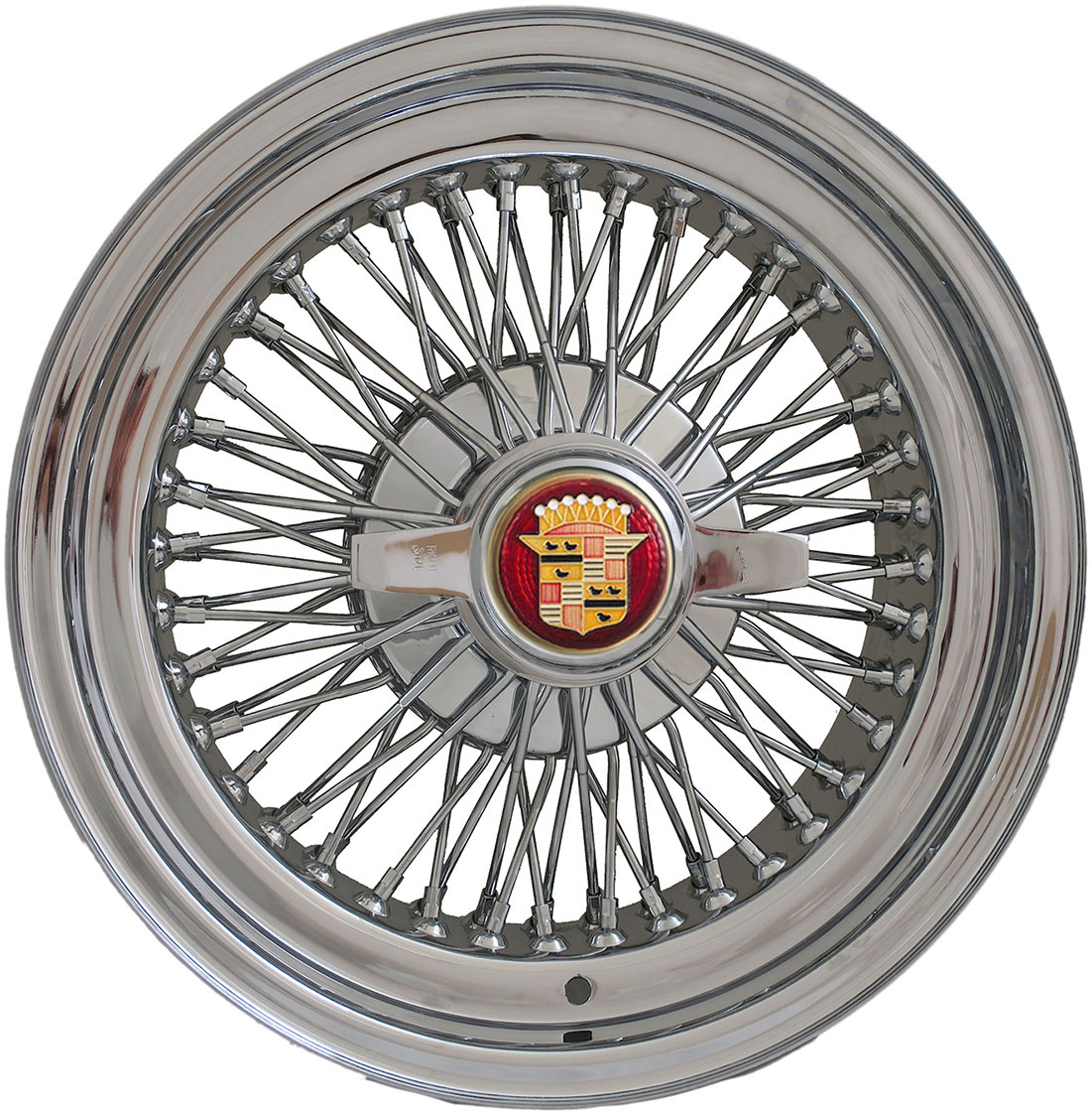 Cadillac wire wheel with two bladed spinner.